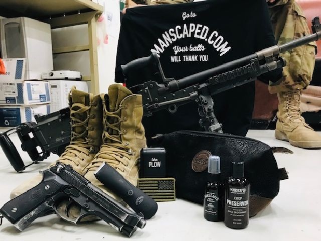 MANSCAPED products next to military equipment