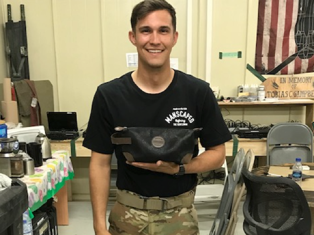 Veteran holding The Perfect Package from MANSCAPED