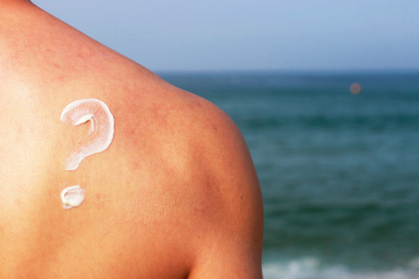 man with sunblock question mark