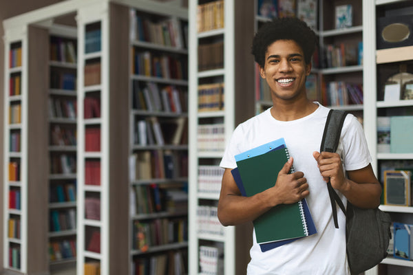 Teen Boy Standing With A Backpack