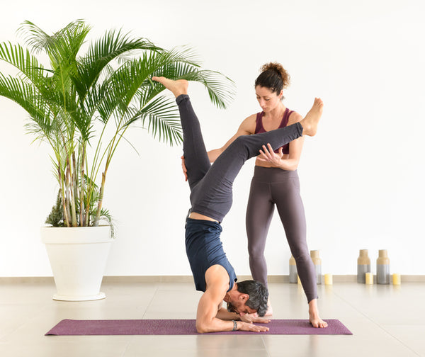 man with yoga instructor