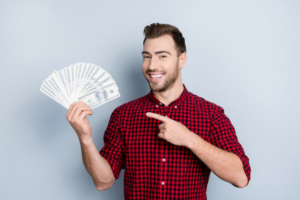young man holding cash