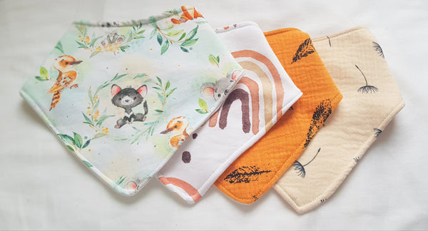 Bandana dribble bibs in a range of prints with bamboo absorbancy. Extra absorbent dribble bibs