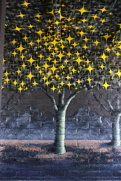 "Christina Thomas' ""Essence of Trees"" mural closeup of one tree with plexiglass stars"