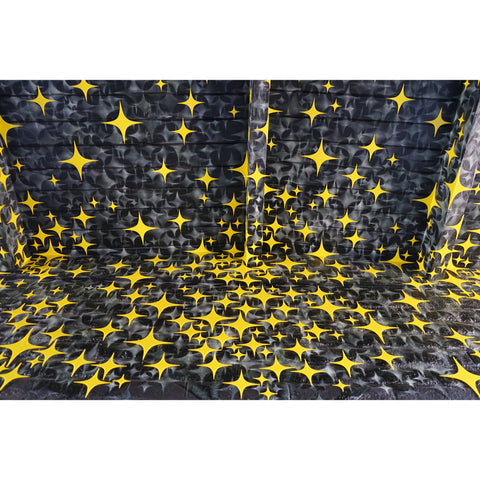 Ceiling spray painted with stars and yellow plexiglass stars on top
