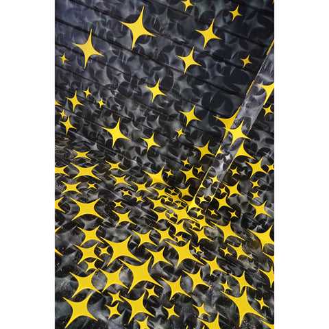 Ceiling painted with stars and yellow plexiglass stars on top