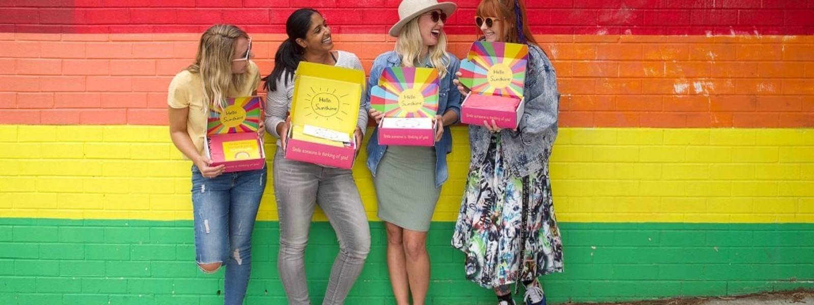4 Australian girls showing their Gift Boxes