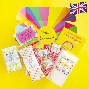 Gift Box items on display with yellow background and UK flag