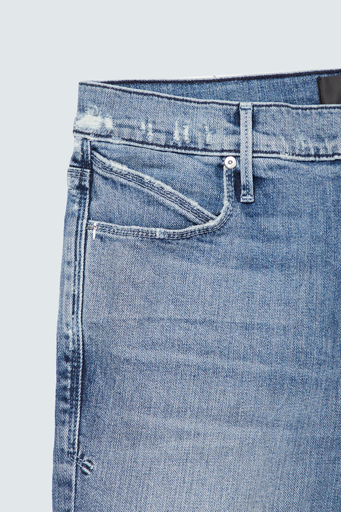 Front pocket of men's American blue skinny jeans