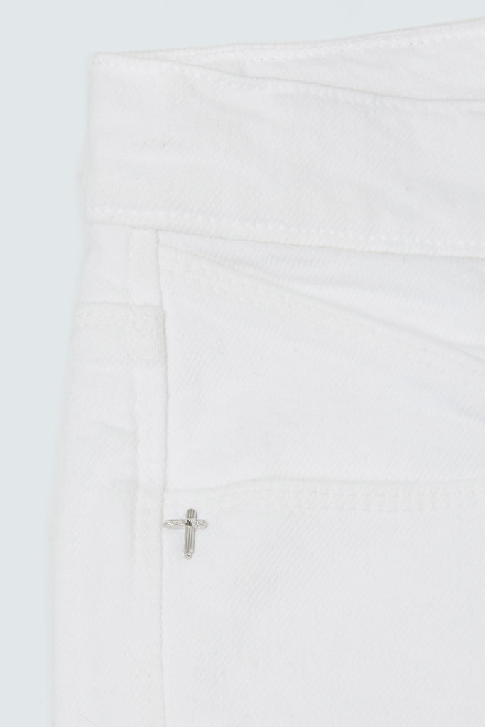 cross detail on white R.I.P. jeans