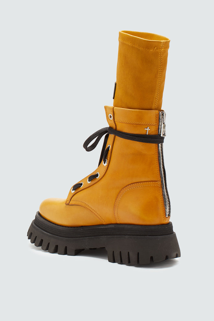 Women's zip-up leather combat boot in mustard yellow