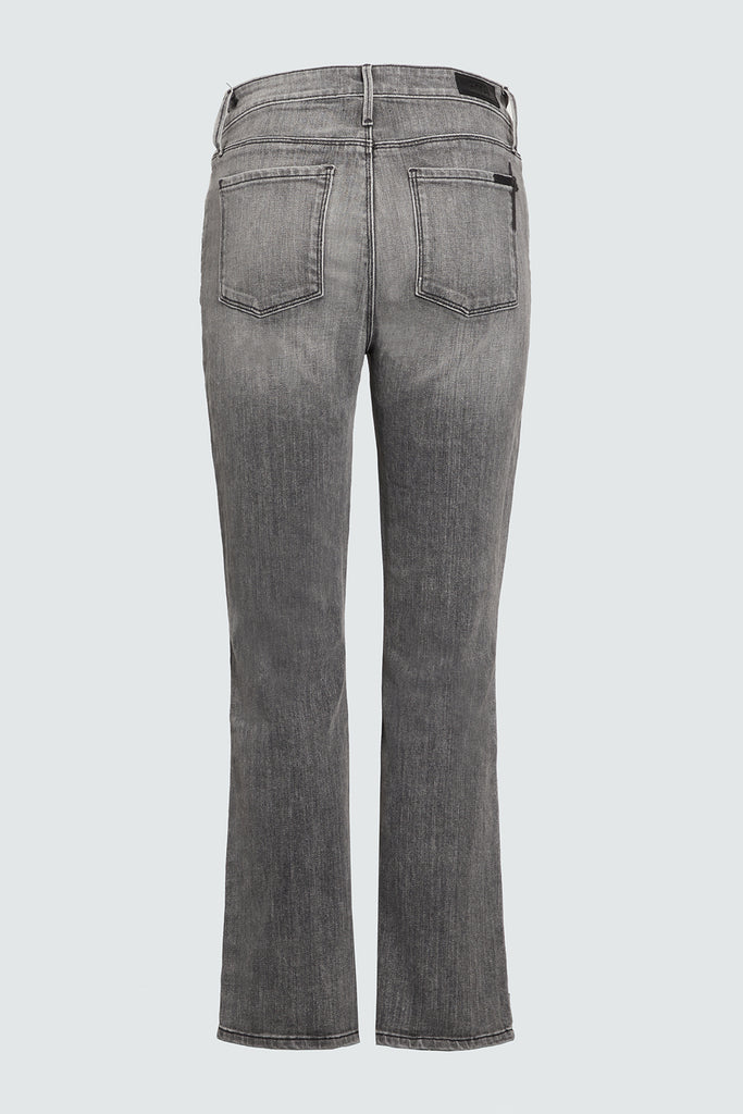 Rear view of grey kick flare cropped denim jean for women