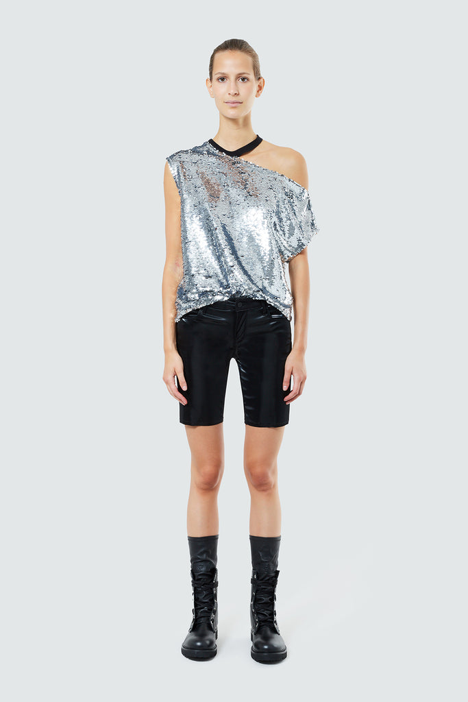 silver sequins axel tee paired with leather shorts & combat boots