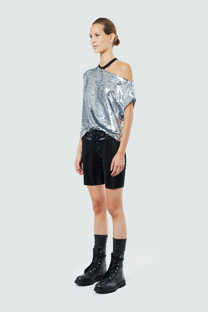 cut out shoulder silver sequins tee paired with leather shorts & boots