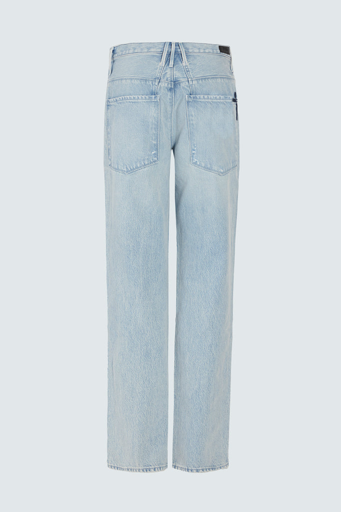 back pockets of light blue distressed jeans for women