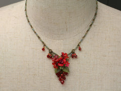 Rosey flames: a small necklace by Colleen Toland