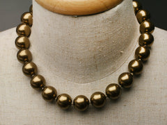 Swarovski knotted large pearl necklace: Antique brass