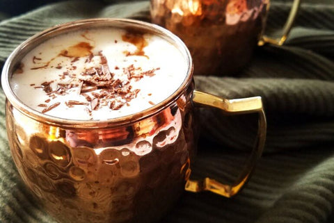Moscow Muled copper mug filled with creamy white liquid and chocolate bits