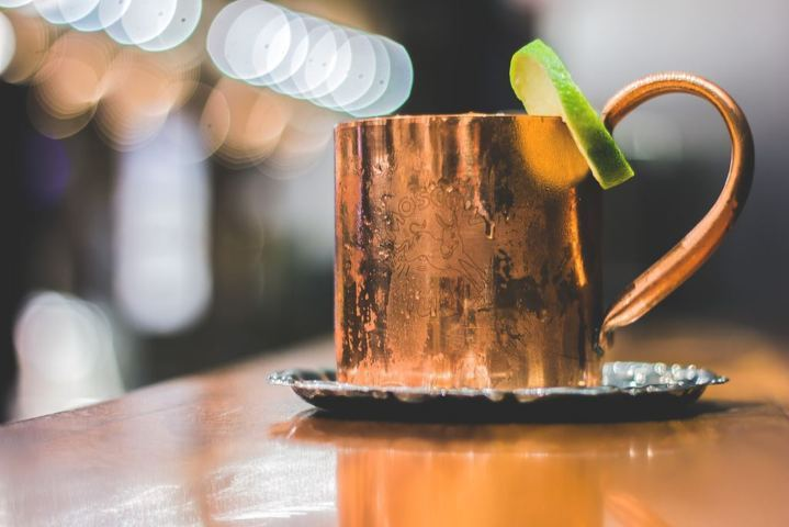 copper mug with lime wedged on the rim moisture on the exterior