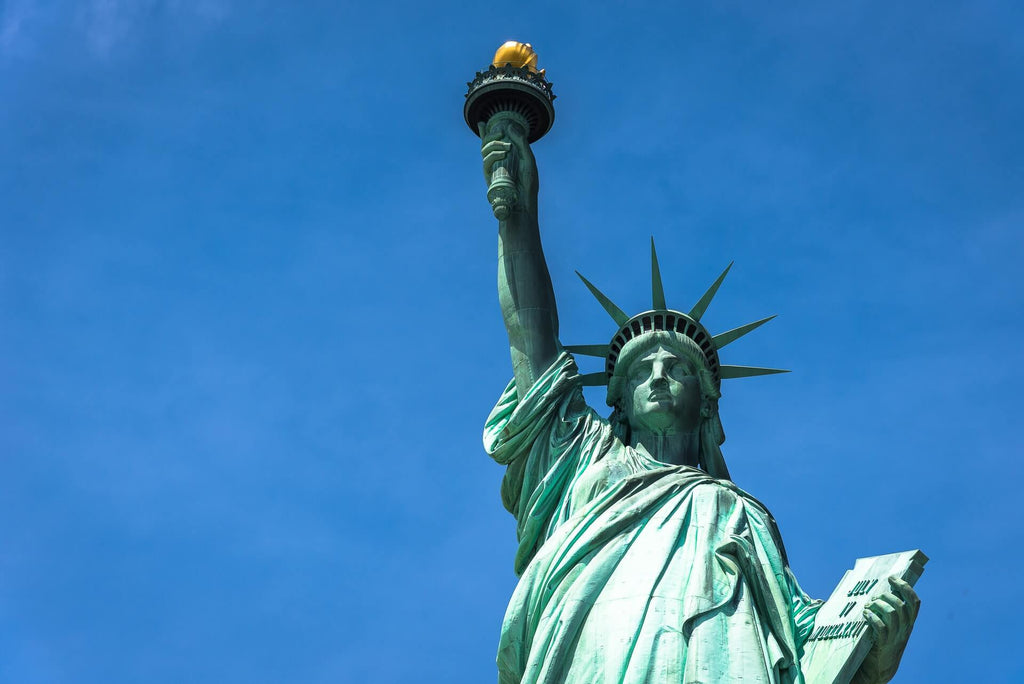 upper half of Statue of Liberty against sky background