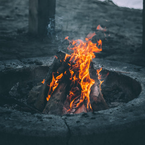 a fire pit burning logs