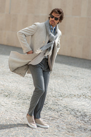 woolen beige coat made in italy with grey trousers, grey scarf and beige sneakers