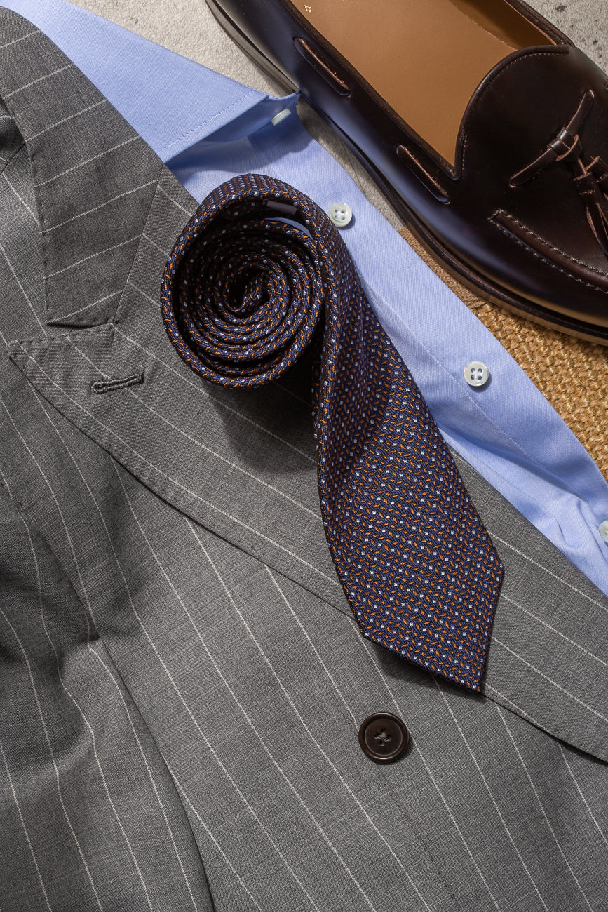 Blue and cognac geometric tie - Made in Italy