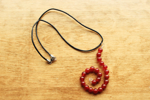 Carnelian Bead Swirl on Leather Cord