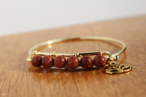 Goldstone and Lotus Bangle Bracelet