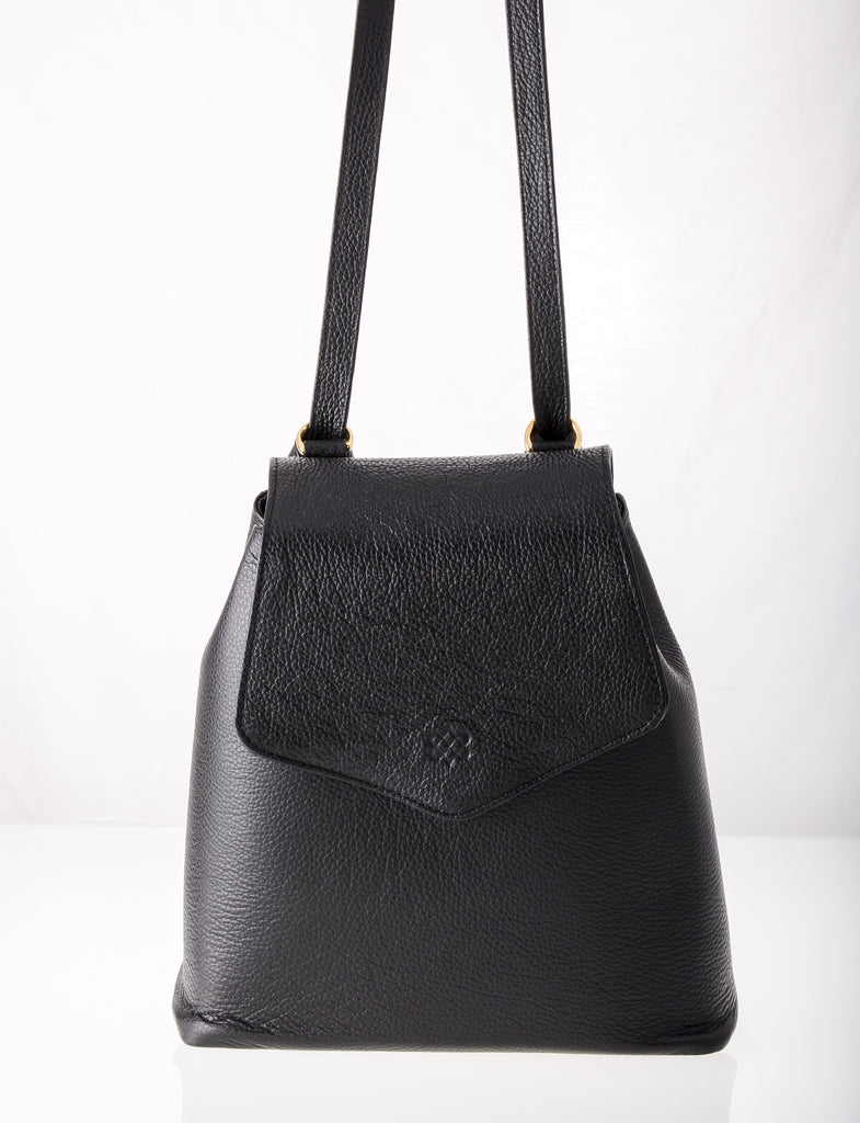 Our trending Kyla Joy Black Leather Long Handle Cross Body Convertible Backpack