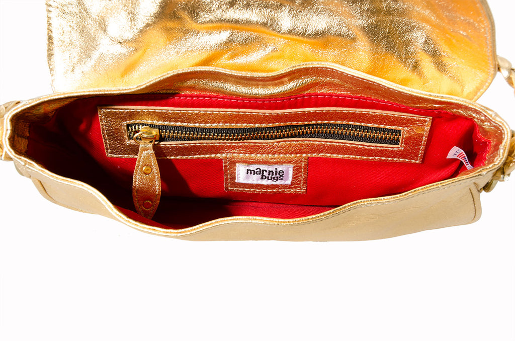 Marnie Bugs Gold Mettalic crafted leather handbag, Marnie Bugs fashinonable shoulder size purse, red fabric lining