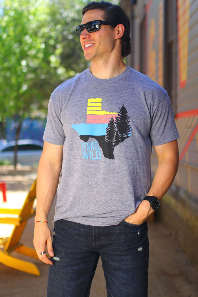 "Burlebo men's ""Find Your Wild"" t shirt. dark heather grey featuring state of Texas and pine trees."