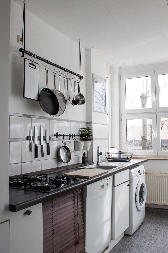 how to decorate kitchen walls with pots and pans