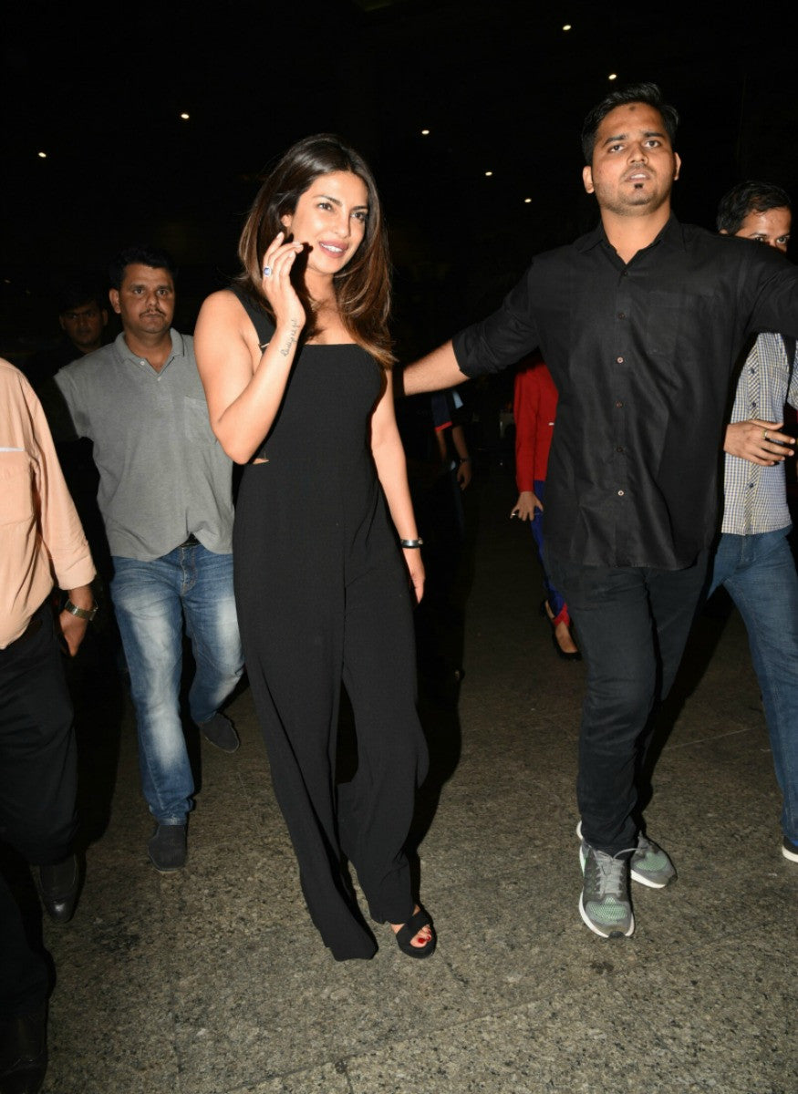 Priyanka Chopra Makes A Stylish Entry In Black Jumpsuit At The Airport