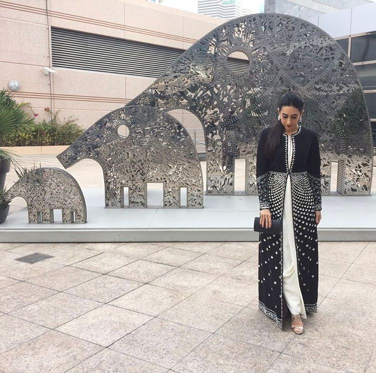 Karishma Kapoor in an elegant white and black Suit with long black maxi jacket from AM:PM