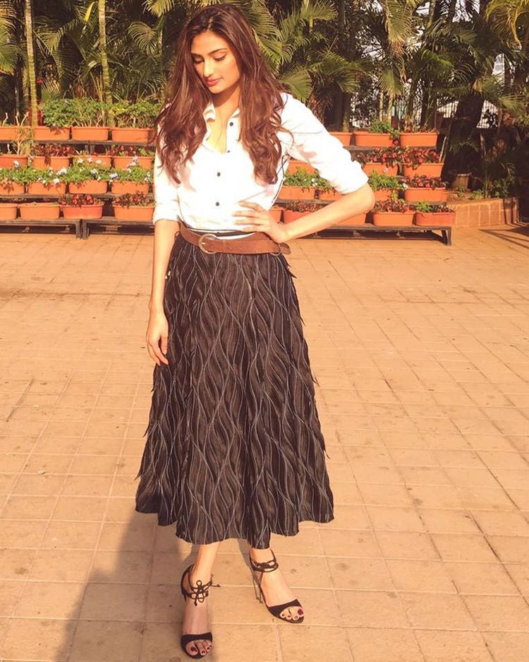 Athiya Shetty in 431-88 by Shweta Kapur's white shirt and a black textured midi skirt