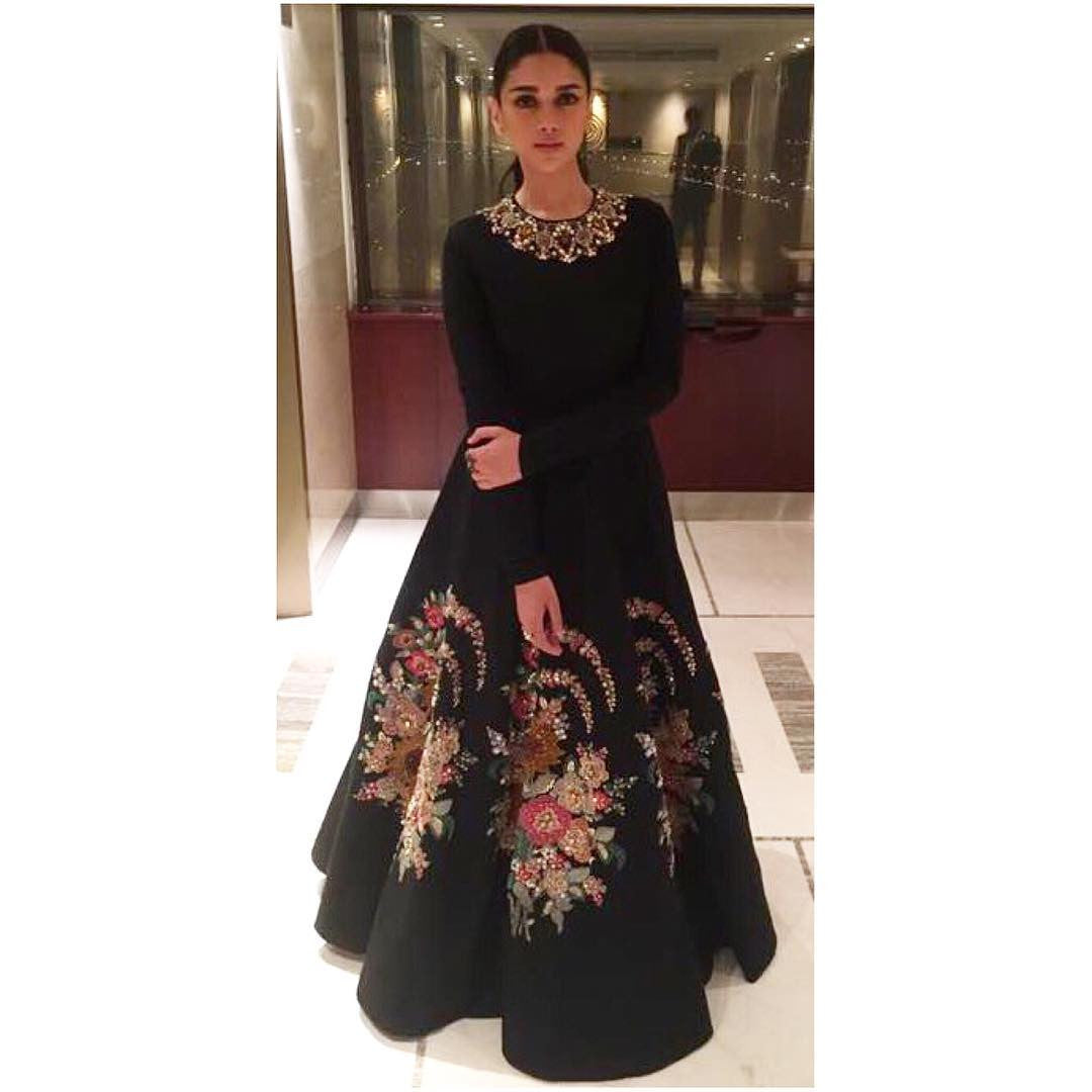 Aditi Rao Hydari in a black floral embroidered gown by Sabyasachi at Kaatru Veliyidai Promotional event