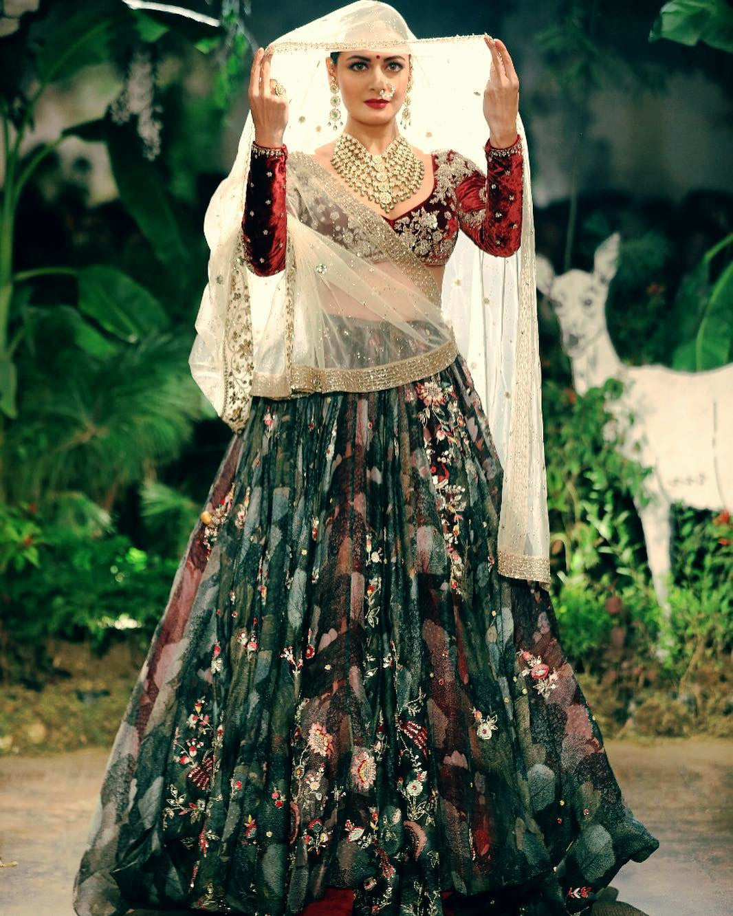 Dia Mirza made a graceful entrance as a showstopper at Anju Modi's shows