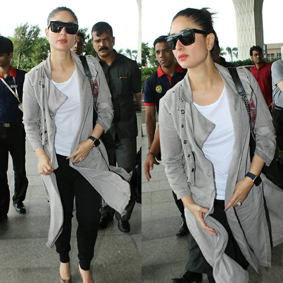 Kareena Kapoor Dressed in a plain white T-shirt, a pair of black jeggings and a long grey jacket,