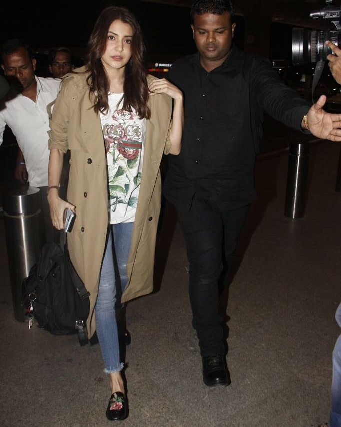 Anushka Sharma opted for a classic Gucci T-shirt and teamed it with destressed jeans