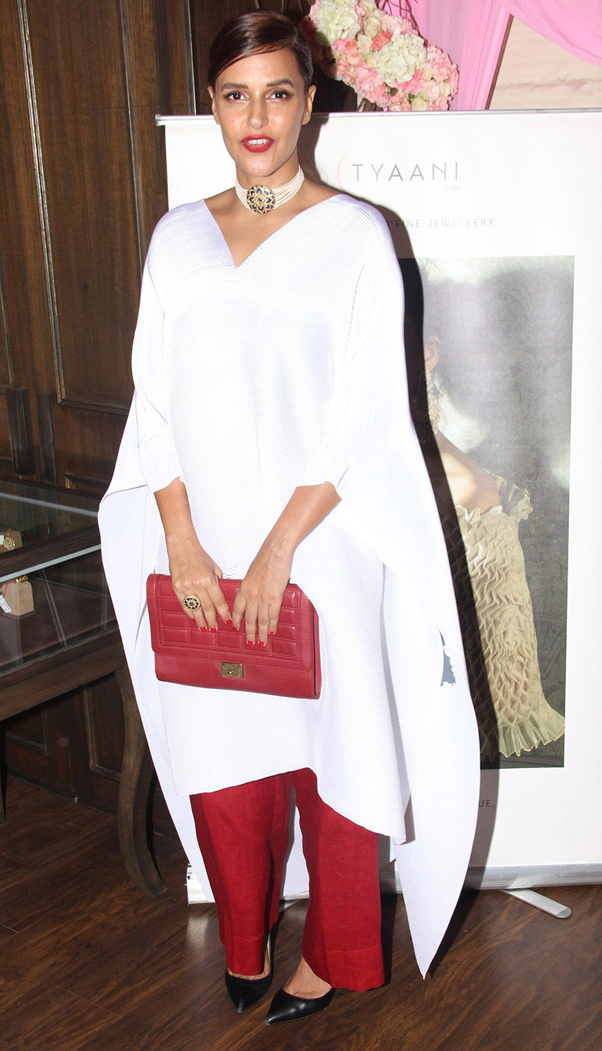 Neha Dhupia Demos How Fashion Girls Are Using This White Cool Fashion's New Trick