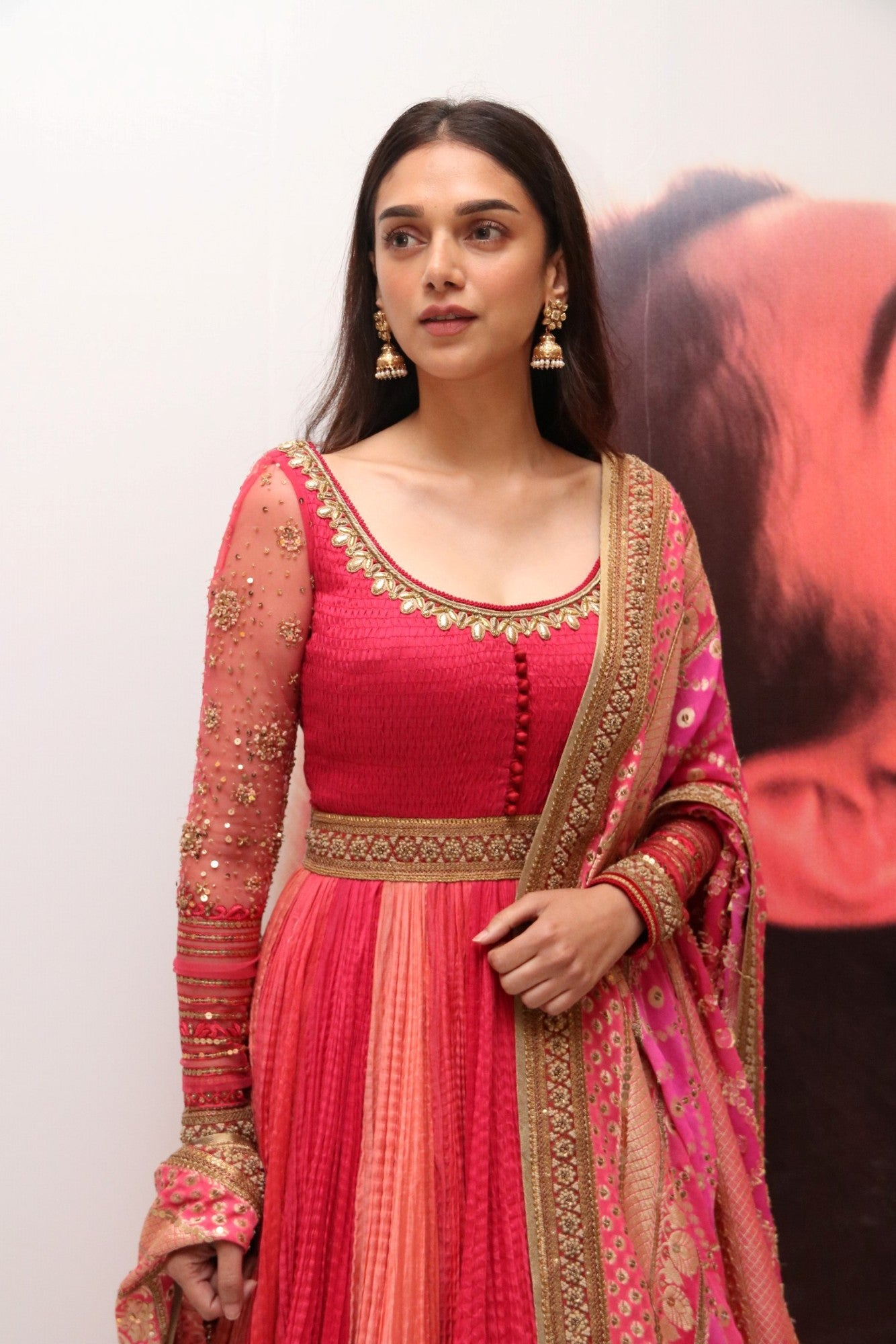 Aditi Rao Hydari in red & pink color Floor Length Crushed Anarkali Suit Indian Ethnic Wear at her upcoming movie Kaatru Veliyidai audio Launch event