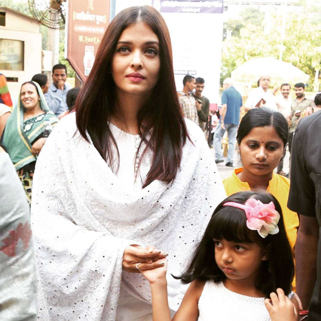 Aishwarya Rai Bachchan wore a white churidar and kurta with a matching embroidered dupatta (all) from Sukriti and Aakriti