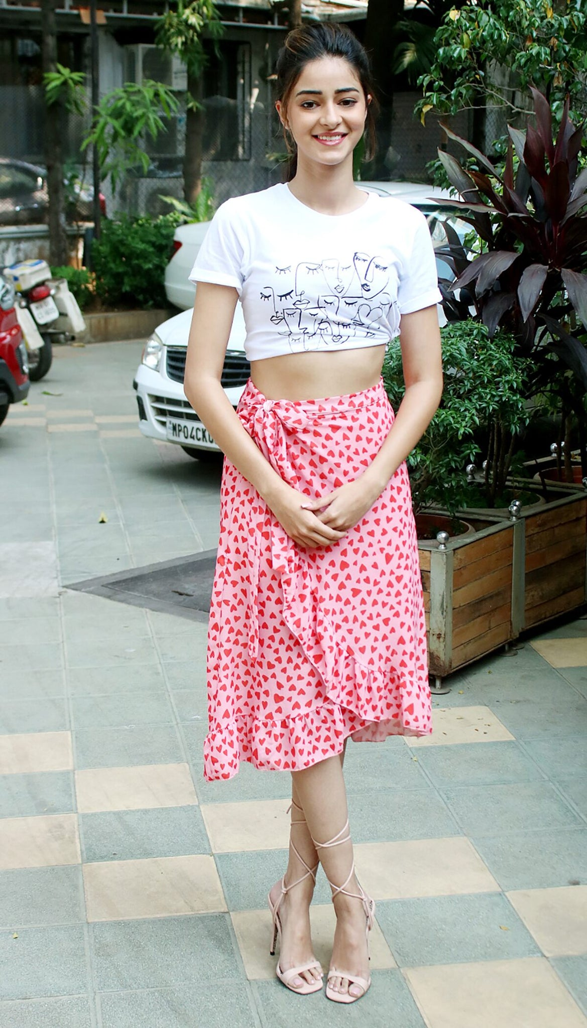 Ananya-Panday-in-pink-printed-skirt-teamup-with-white-crop-top
