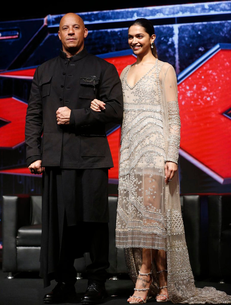 Deepika Padukon and Vin Diesel in Sabyasachi's designer golden western wear