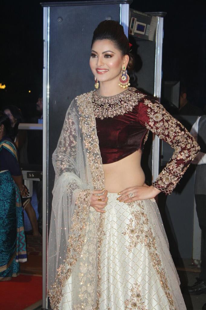 Urvashi Rautela flaunted her envious slim frame wearing a bridal lehenga choli at Neil Nitin Mukesh and Rukmini Sahay's wedding reception.
