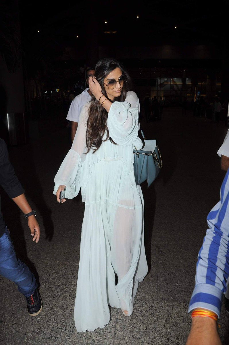 Sonam Kapoor in Chloe Spring 2015 Collection's Maxi Dress with bat sleeves design at Airport