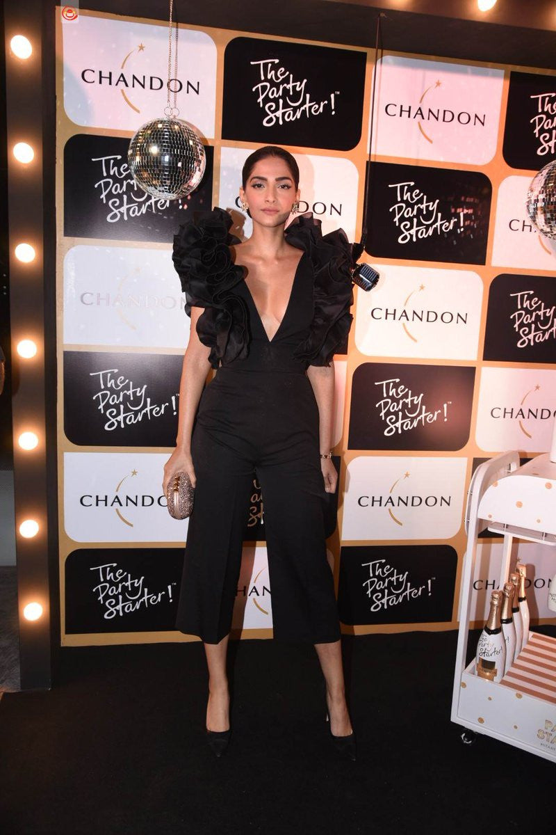 Sonam Kapoor in black cropped jumpsuit with ruffled detailing around the neckline Designer western wear from Rosario Atelier Collection