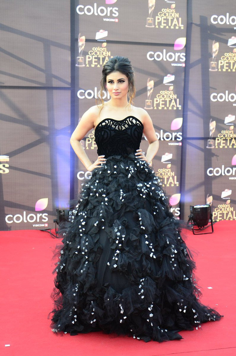 Mouni Roy wore a black strapless gown with a tulle and floral applique ball gown skirt by Karleo at Golden Petals Award