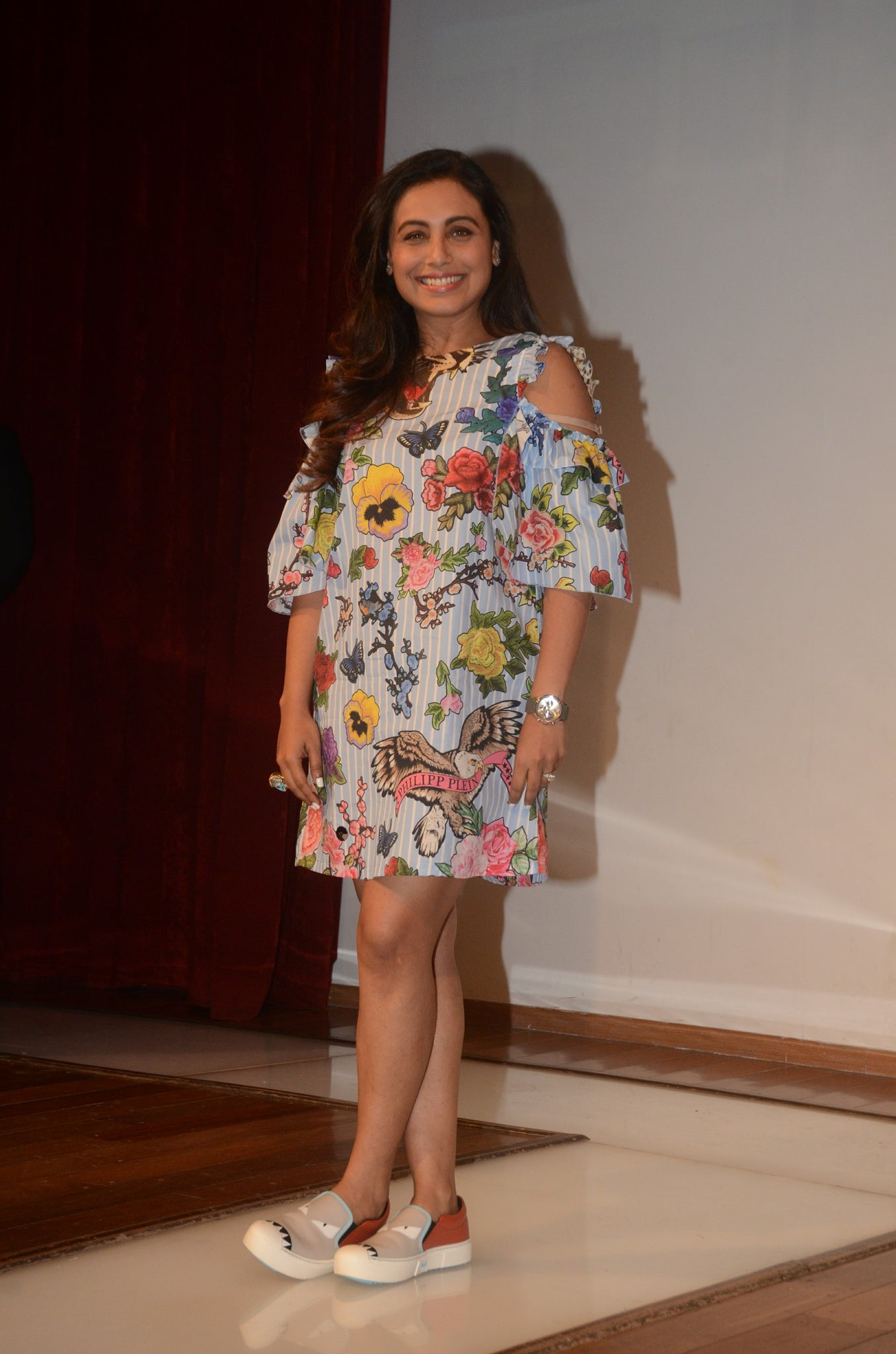 Rani looked pretty in a floral printed cold shoulder midi dress with quirky shows. Quirky loafers simple curls added elegance to the fun look.